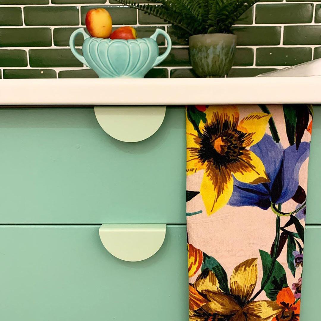 neo mint mezzaluna handle on green cupboard in green and white kitchen