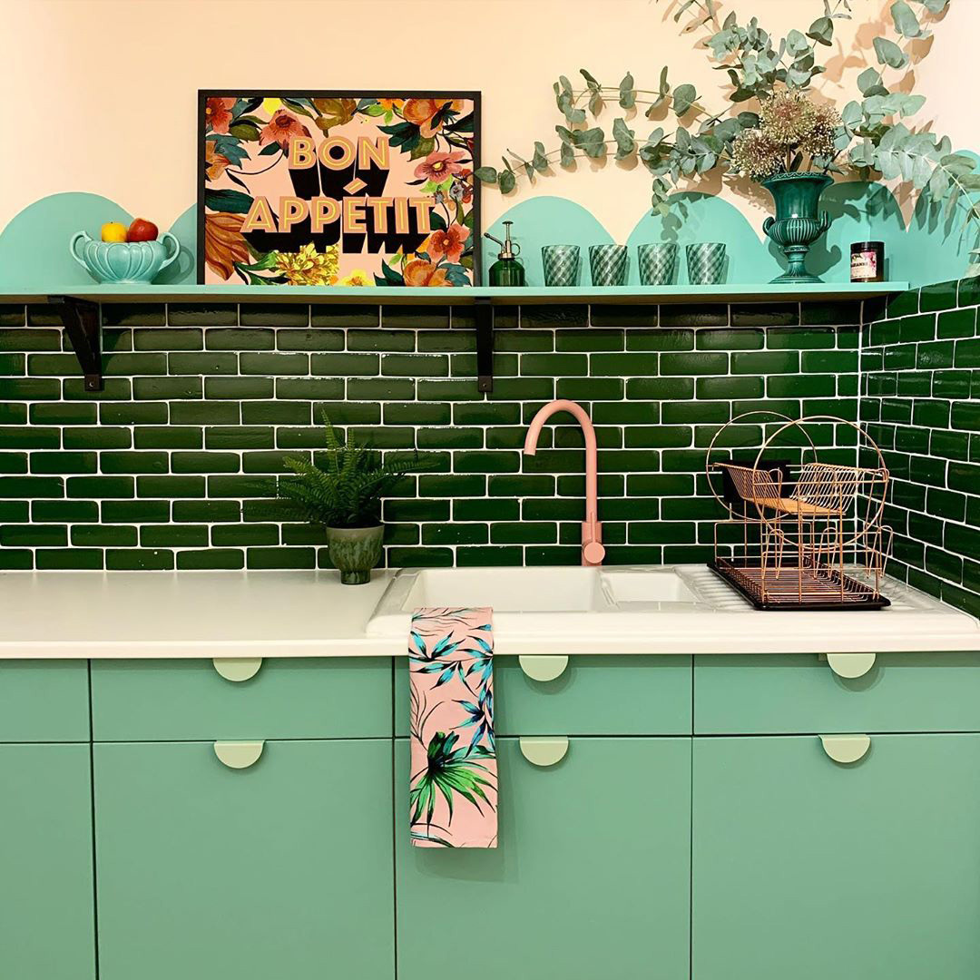 pink tinkisso tap and neo mint mezzaluna kitchen door handles in a green kitchen