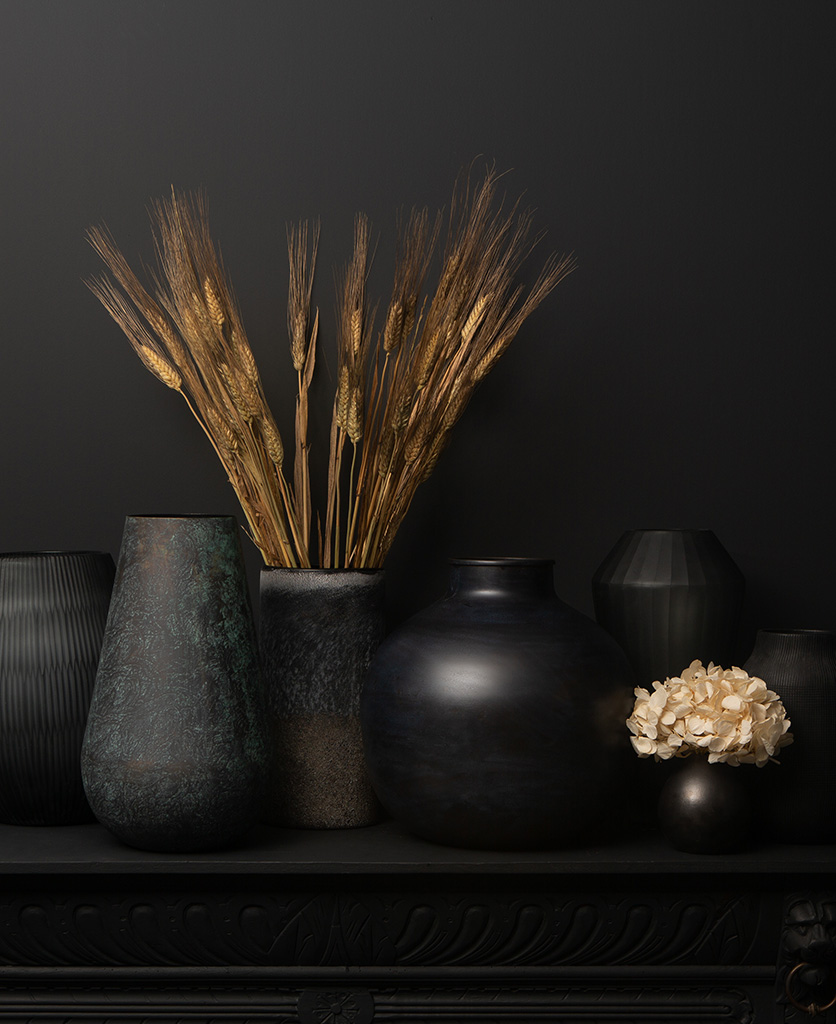 vase collection with foliage on back background