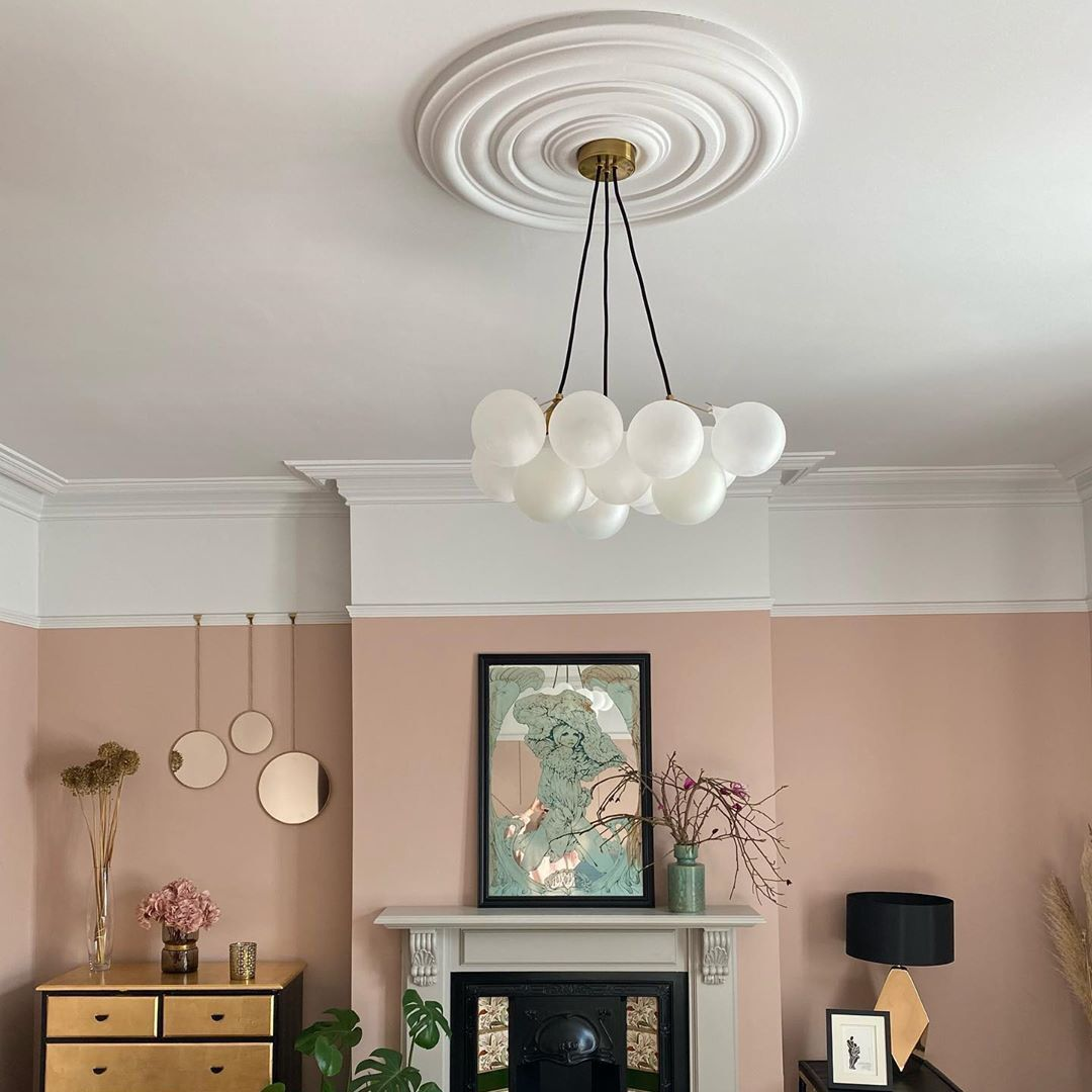frosted bubble chandelier in piank and white living room