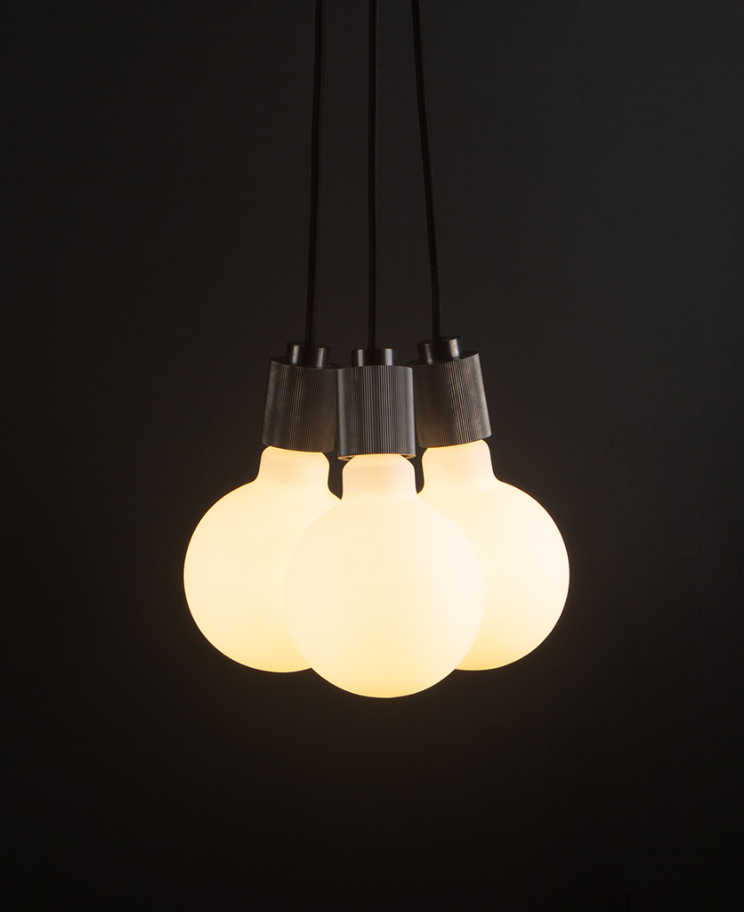 lutetia antique black triple pendant lighting with opal bulbs on black background