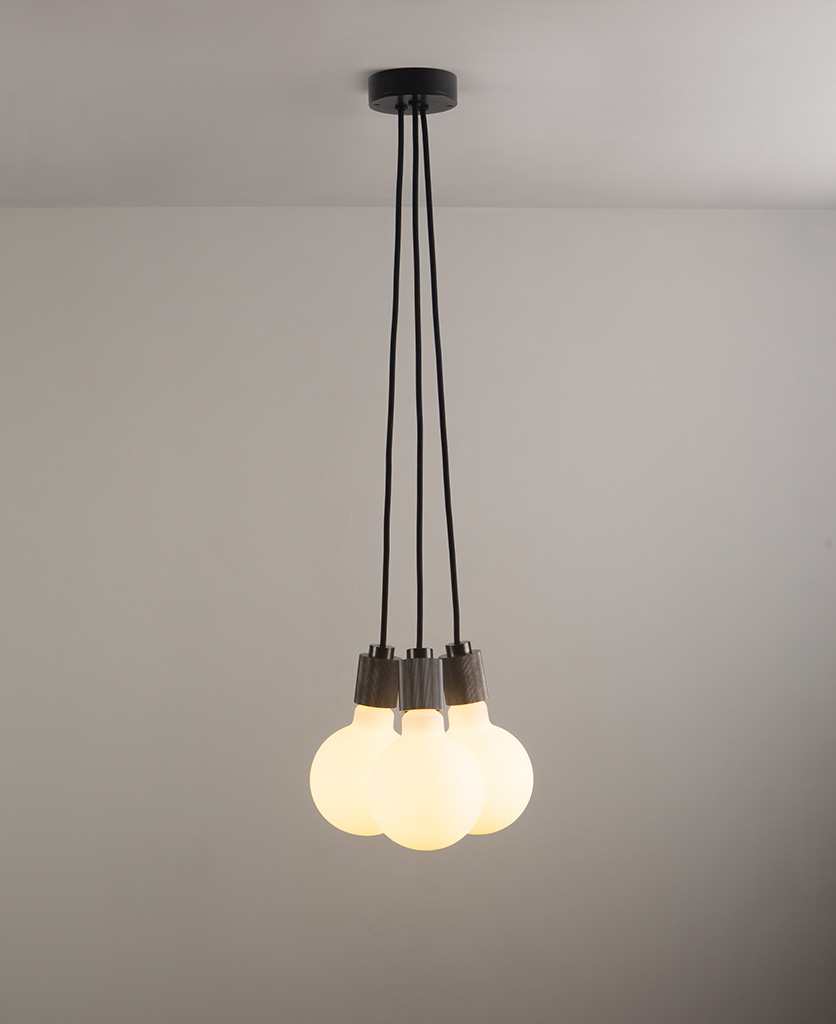 lutetia antique black triple pendant lighting on grey ceiling and wall