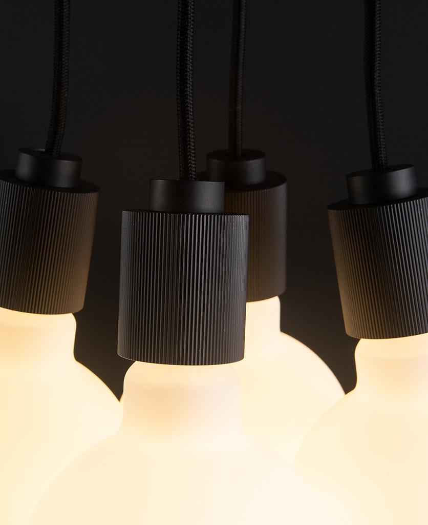 henriette black pendant light close up with four bulbs