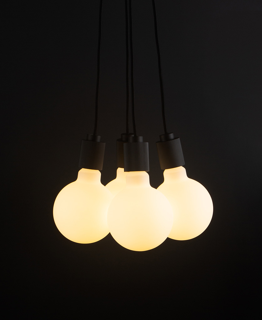 henriette black pendant light with four bulbs on black background