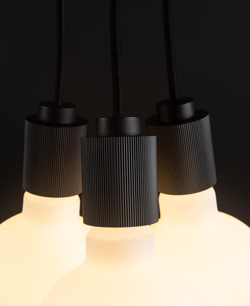 triple lutetia black pendant lighting close up on black background