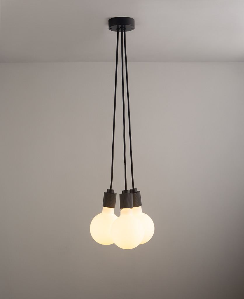 lutetia black triple pendant lighting on grey ceiling and wall