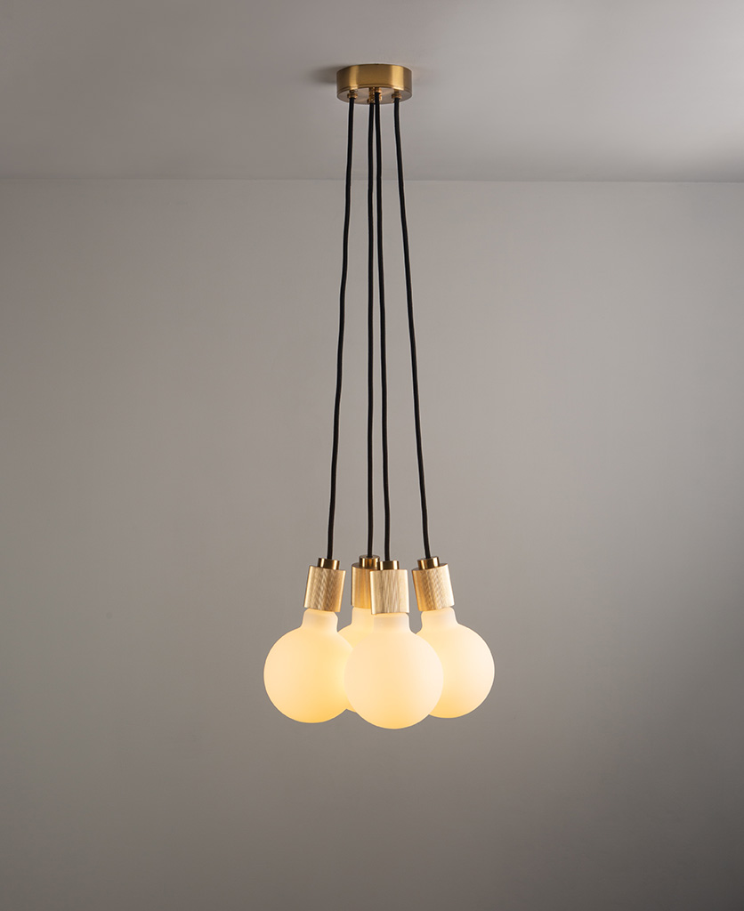 henriette gold pendant lighting on grey ceiling and wall