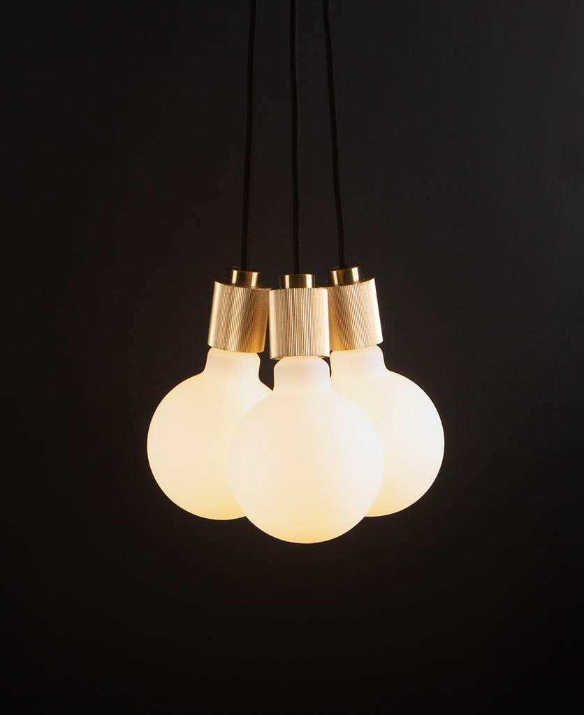 lutetia gold and black pendant lighting with three opal bulbs