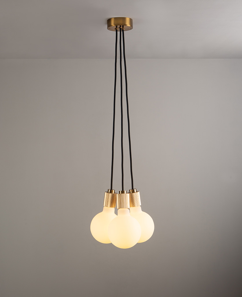 lutetia gold triple pendant lighting on grey ceiling and wall