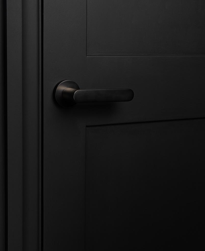 graphite interior door handle on black door