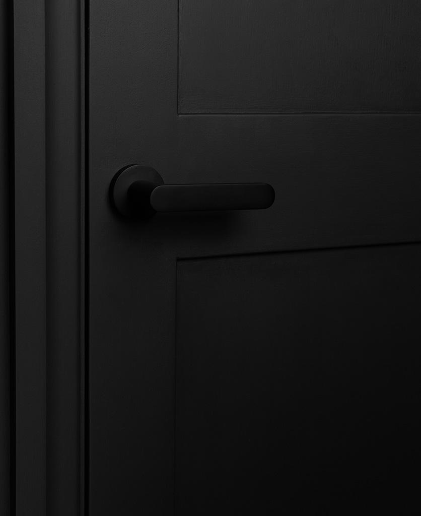 black interior door handle on black door