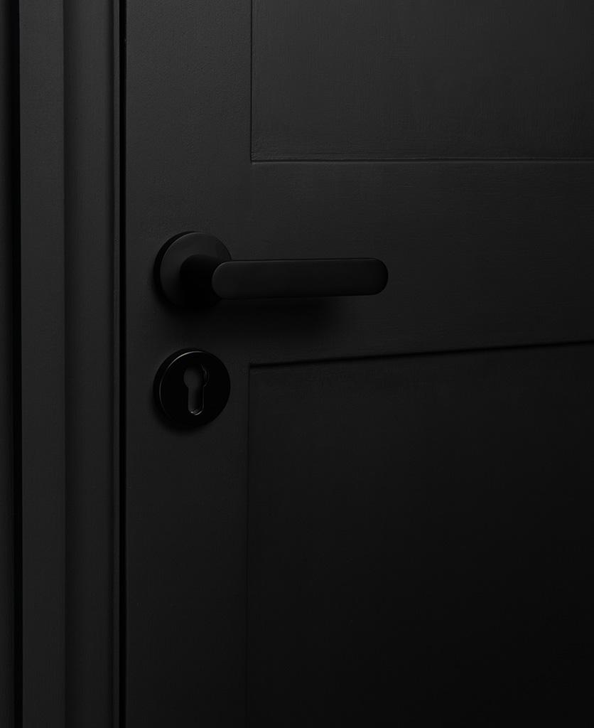 black interior door handle with escutcheon on black door