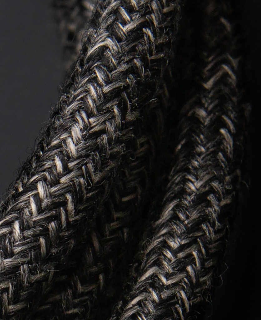 close up of fishermans jumper fabric extension cable against black bakground