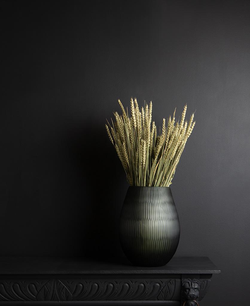 Wheat with grey textured vase on dark background