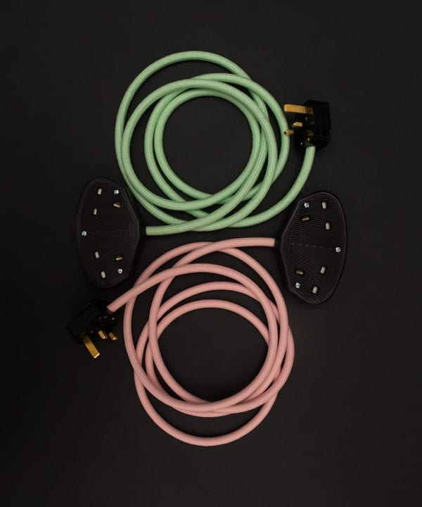group shot of miami pinke xtenasion lead and neo mint extension lead against black background
