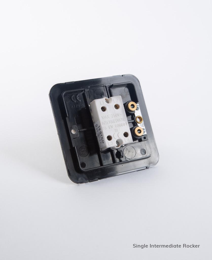 single intermediate rocker switch backplate on white background