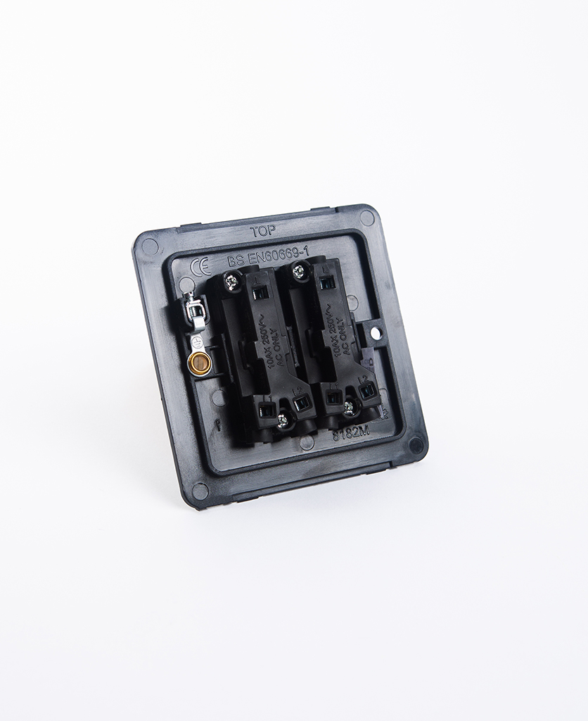 double rocker switch backplate on white background
