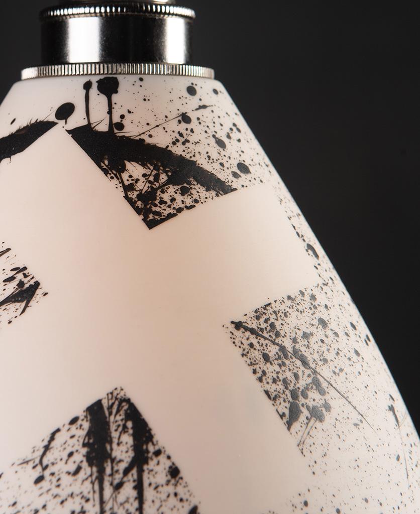 close up of michael o hare ceramic pendant light against black background