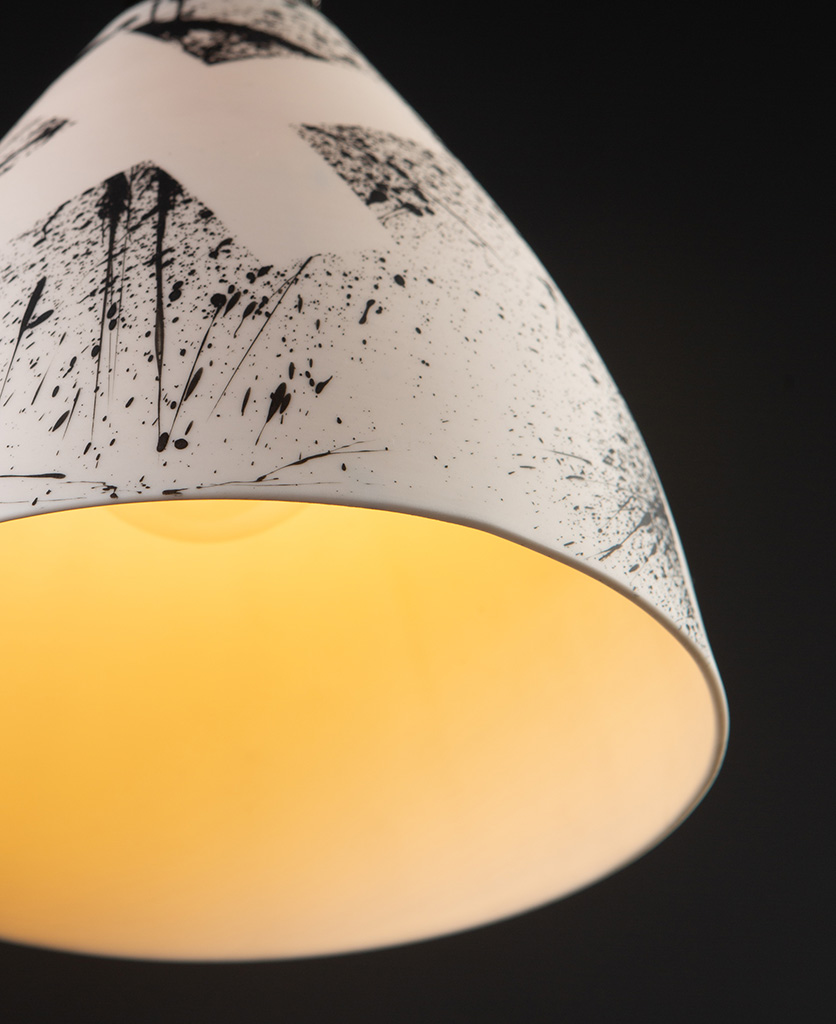closeup view of Michael O Hare porcelain ceiling pendant against black background