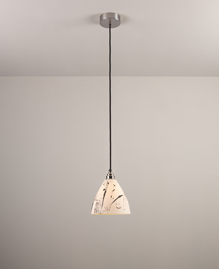michael o hare ceramic pendant light suspended from a grey ceiling against a grey wall