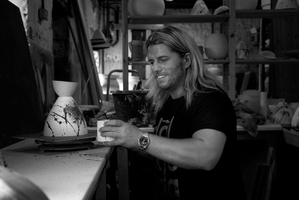 Michael O Hare at working painting the ceramic light shades