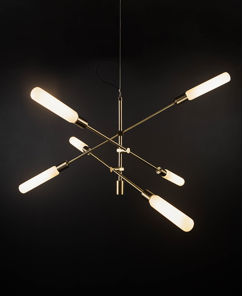brass feature pendant lights with luna opal bulbs on black background