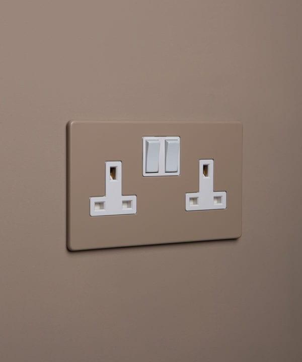 caramel latte double plug socket with white insert on caramel latte background