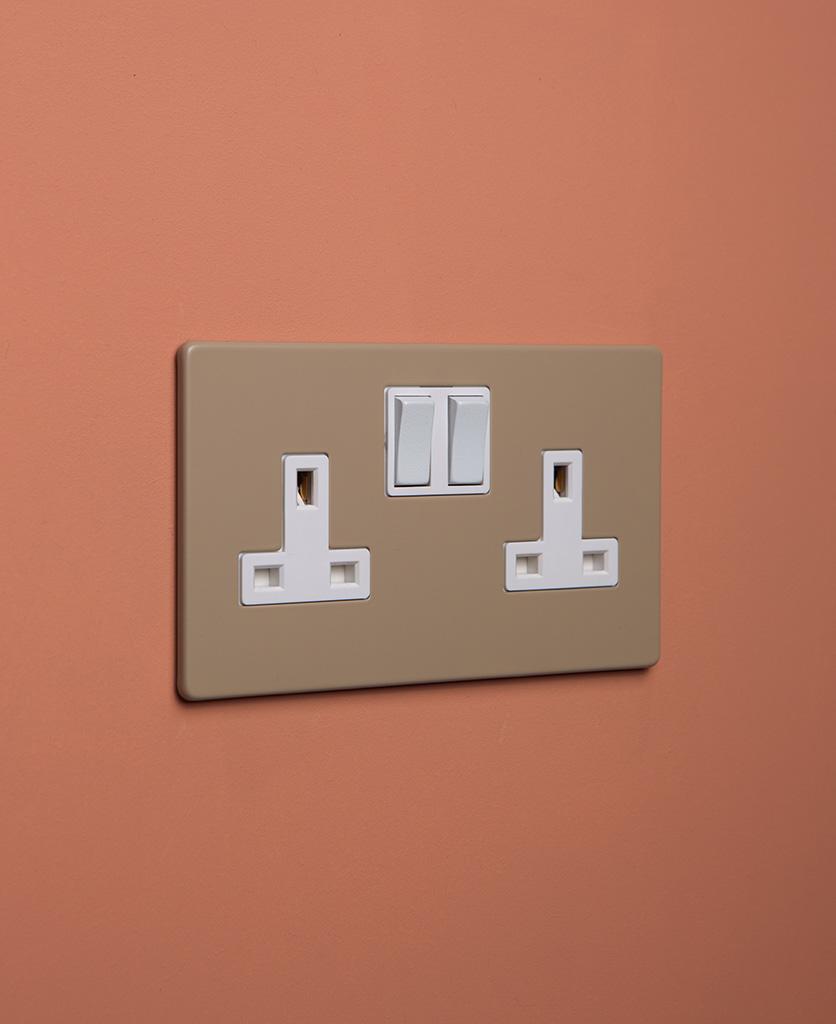 caramel latte double plug socket with white insert on cinnamon background