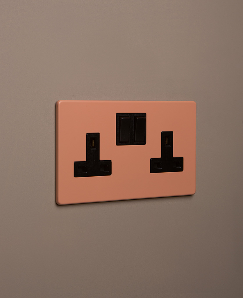 cinnamon double plug socket with black insert on caramel latte background