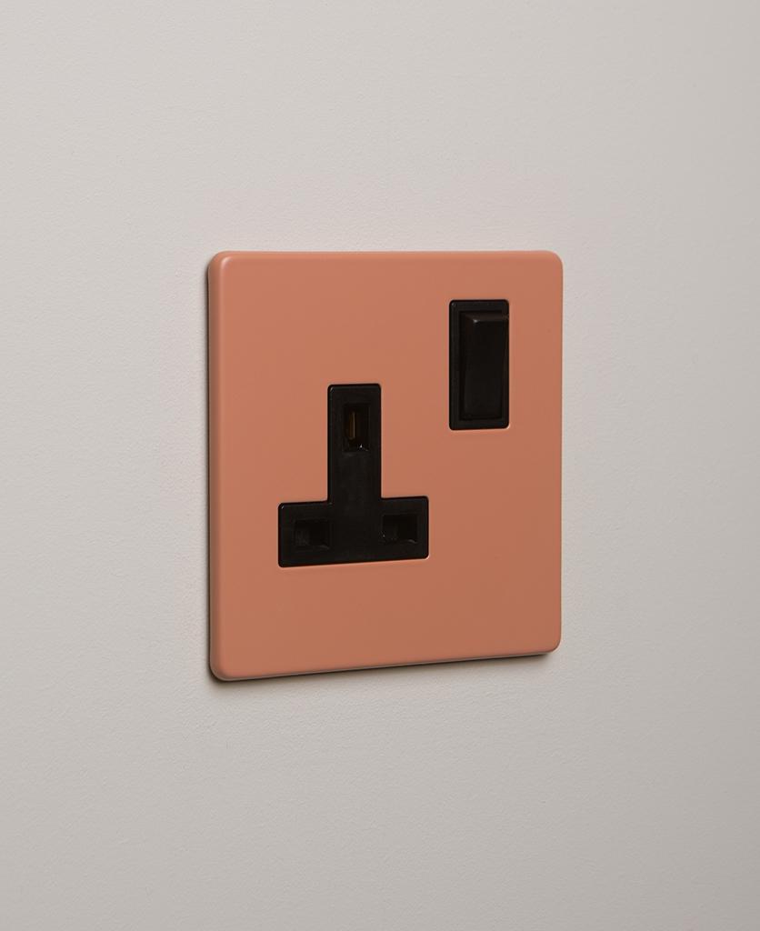 cinnamon and black single plug socket