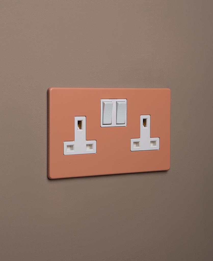cinnamon double plug socket with white insert on caramel latte background
