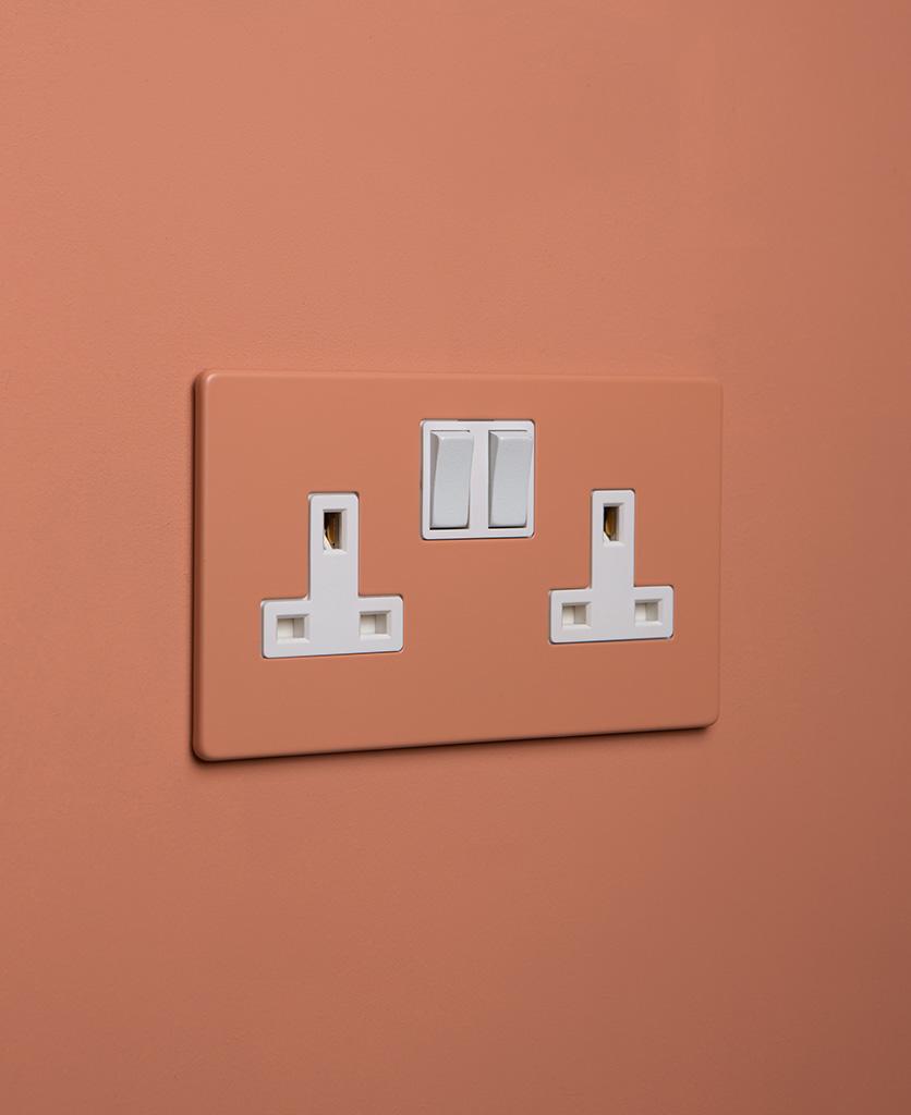 cinnamon double plug socket with white insert on cinnamon background