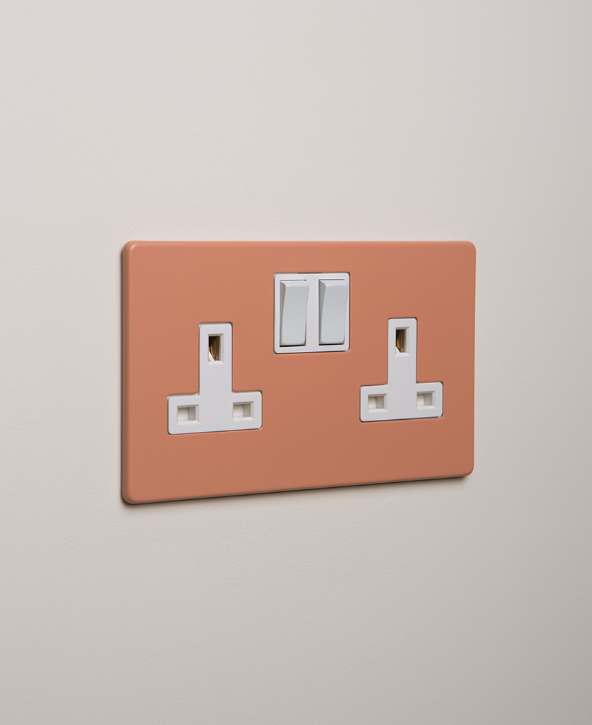 cinnamon double plug socket with white insert on white background