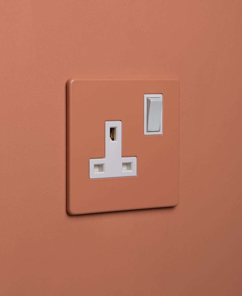 cinnamon and white single plug socket