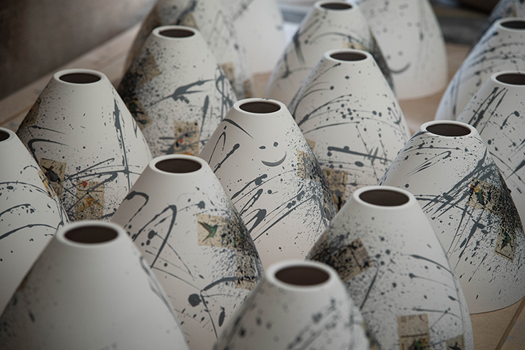 Group shot of hand painted ceramic light shades at Laverick and Son studios