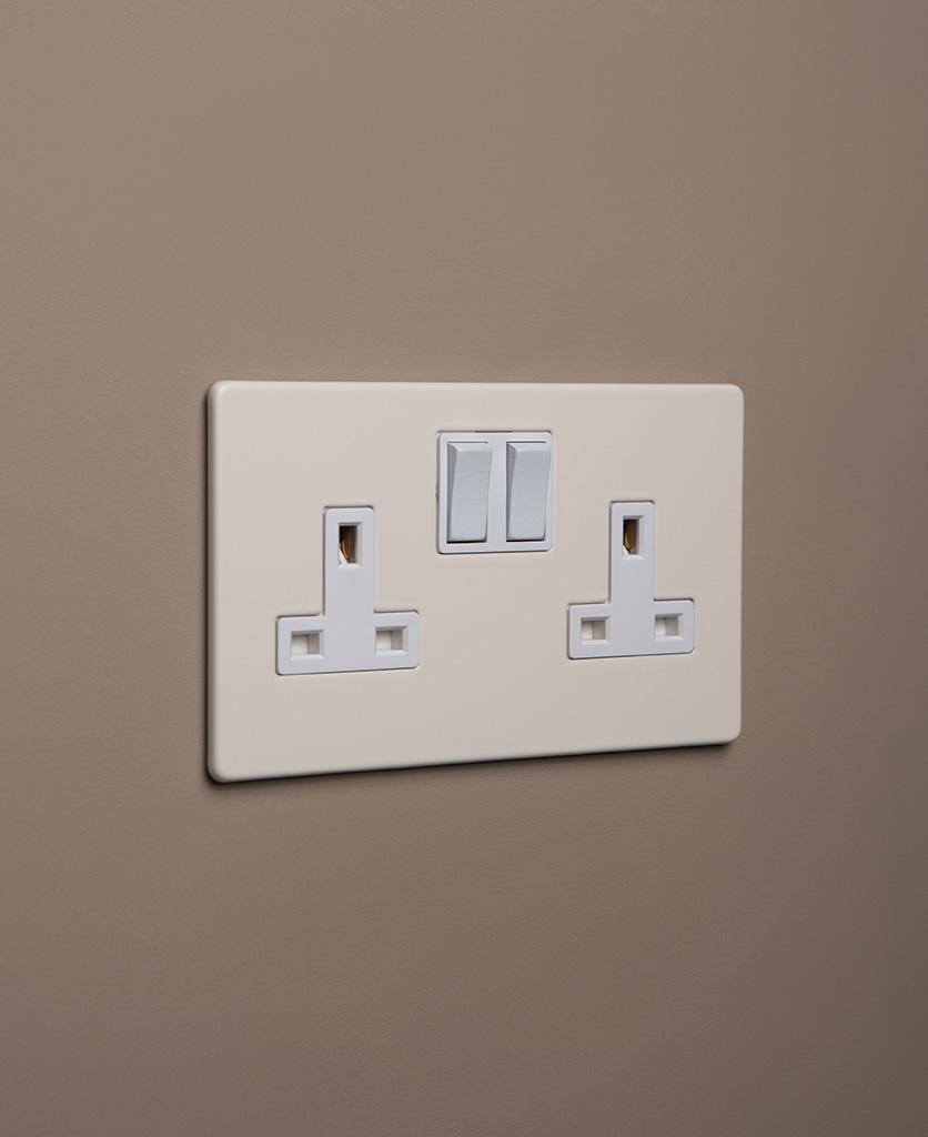 whipped cream double plug socket with white insert on caramel latte background