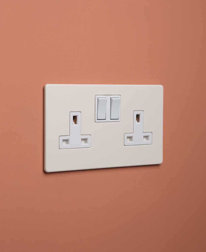 whipped cream double plug socket with white insert on cinnamon background