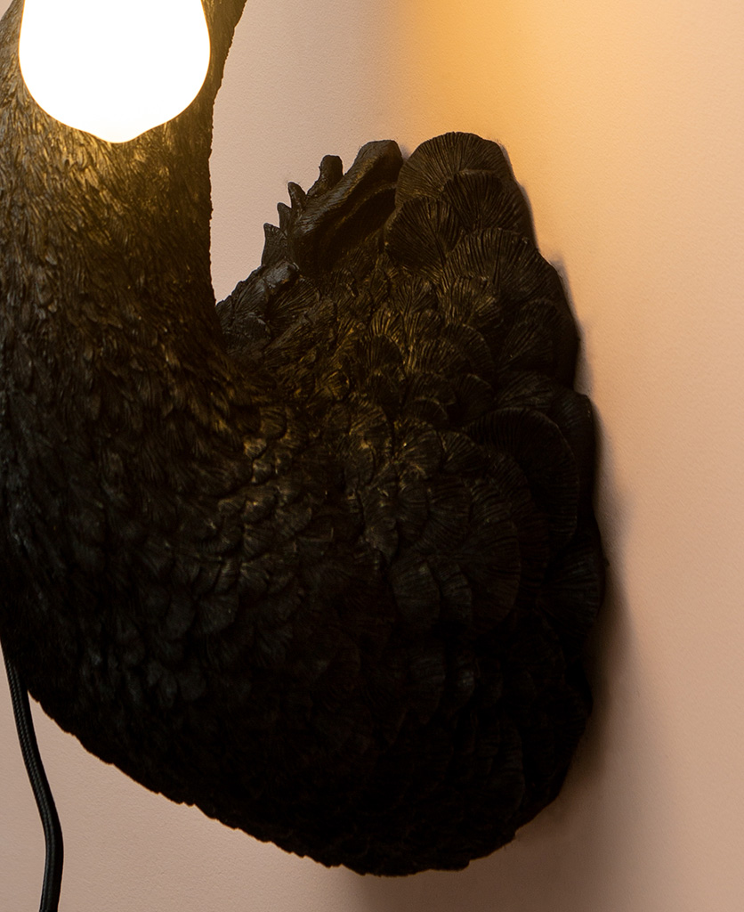 black swan wall light close up