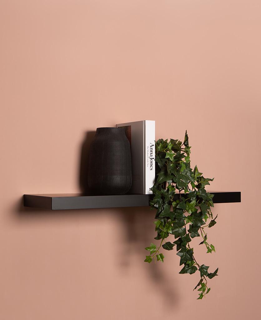 large black floating shelf on pink background