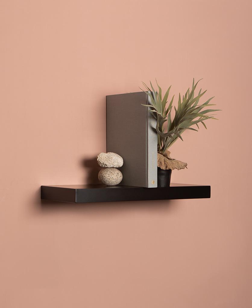 medium black floating shelf on pink background