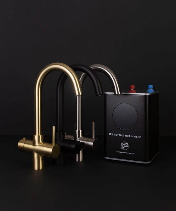 gold black and silver hot water tap with boiler