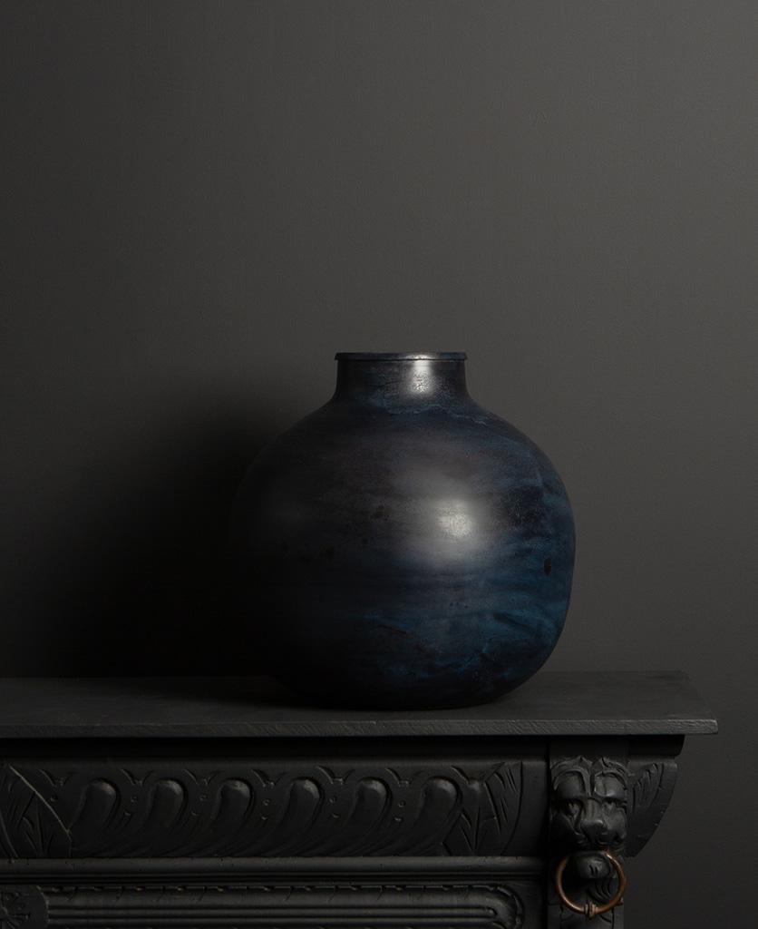 large blue grey vase on dark background