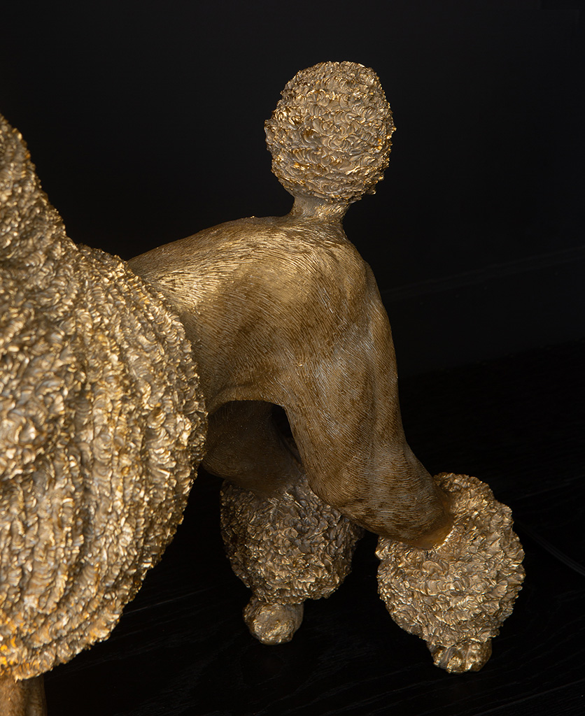 Claude Poodle Table Lamp in gold on black background close up