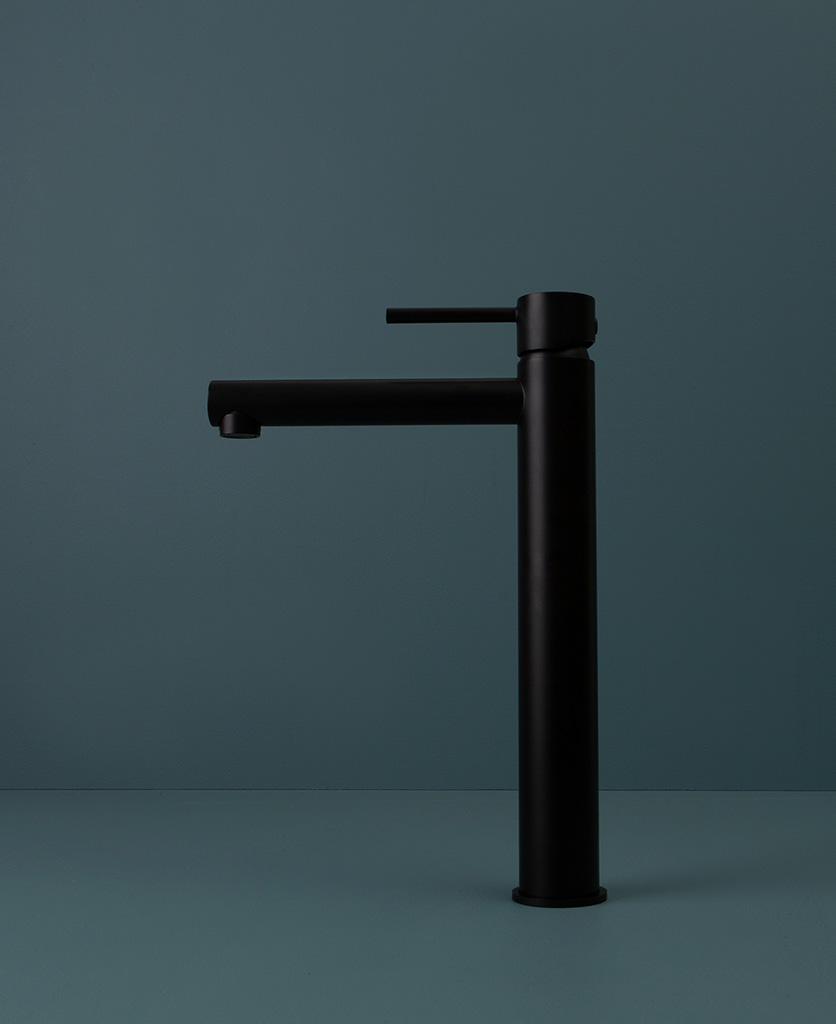 black inga tap side angle on blue background