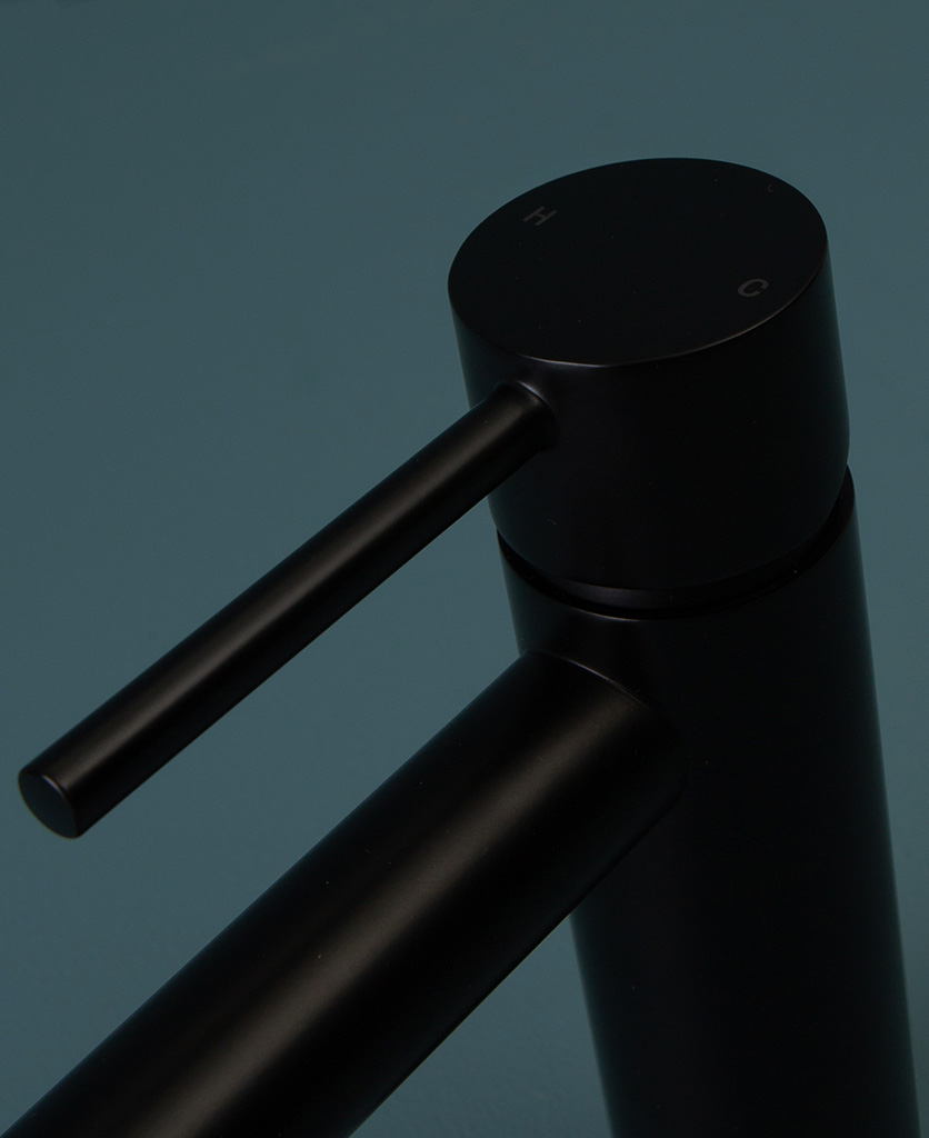 black kagera tap close up of handle hot and cold on blue background