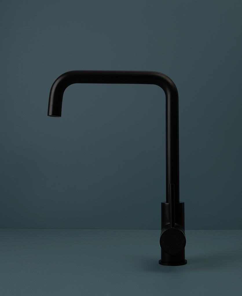 black kintampo tap side angle on blue background