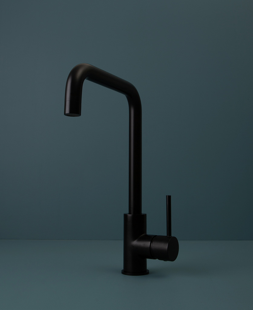 black kintampo tap on blue background