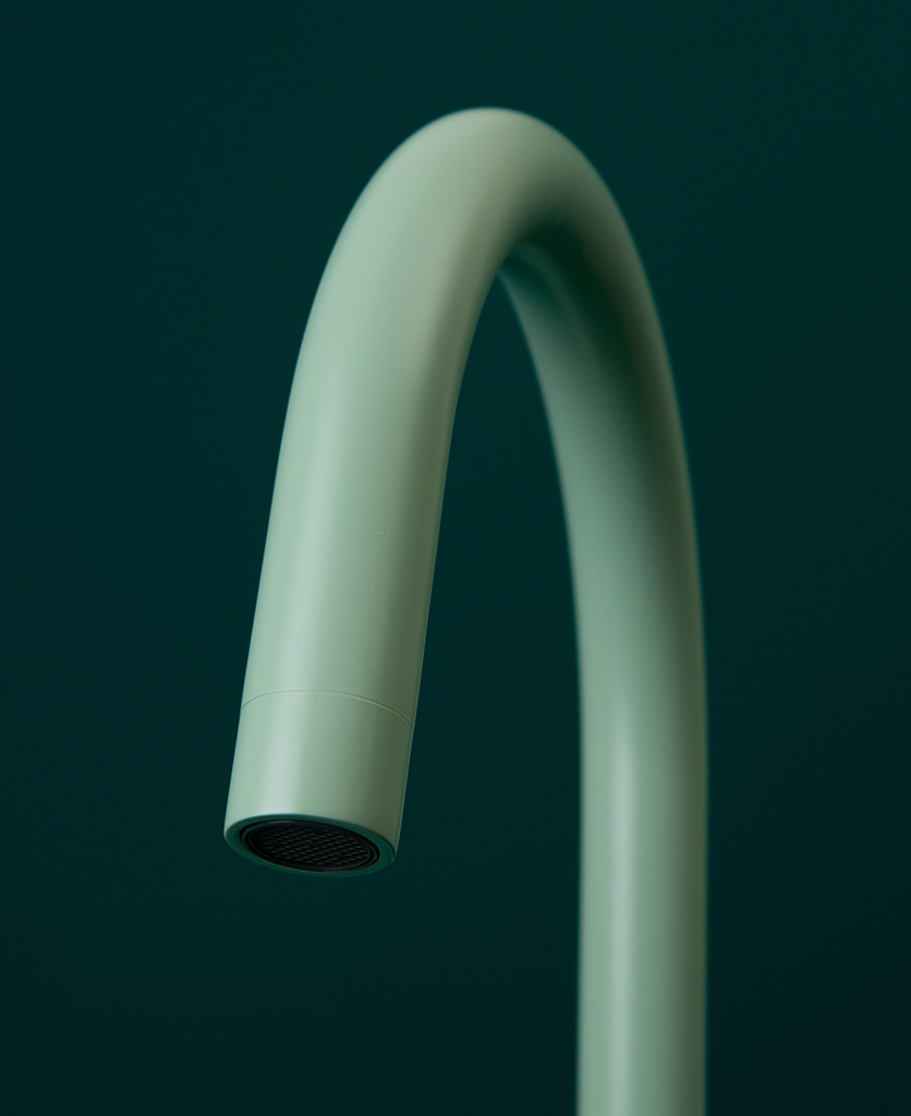neo mint tinkisso tap close up of spout on dark green background