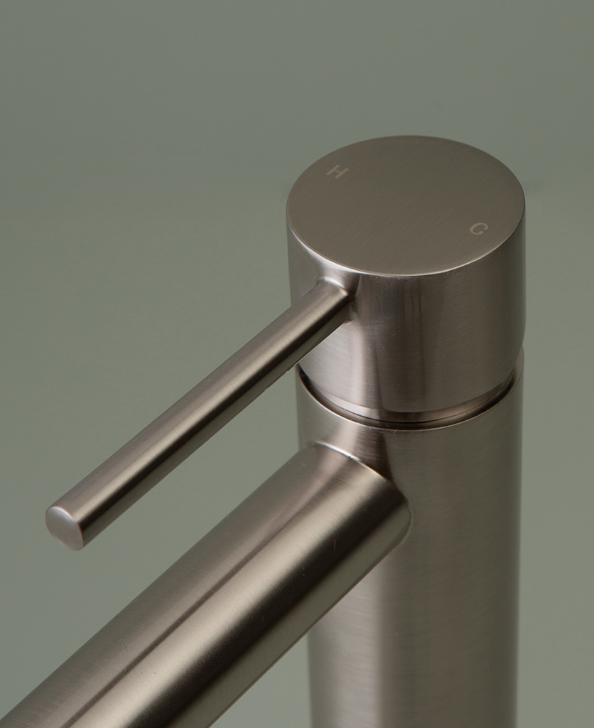 silver inga tap close up of handle on grey-green background