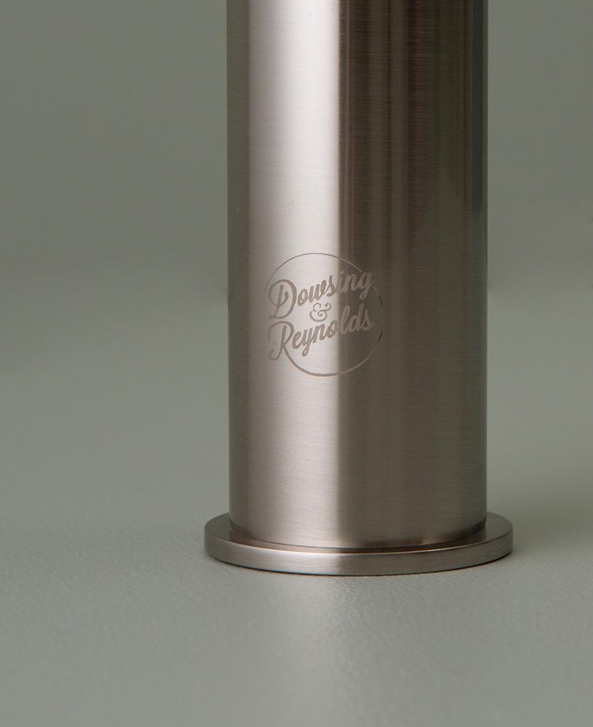 silver inga tap close up of logo on grey-green background